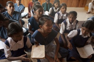 Girls participate in class at a girl's boarding school in Dolkhamb, Maharashtra, India.